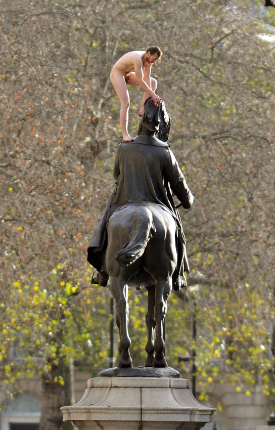 Naked man who mounted London statue now jailed (PICTURED