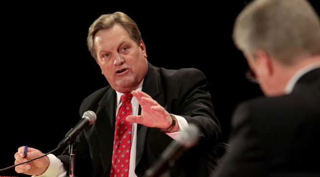 GOP candidates U.S. Rep. Mike Simpson, left, debates challenger Bryan Smith at Canyon Ridge High School on April 25, 2014 in Twin Falls, Idaho. The 2nd Congressional Representative GOP debate Friday night hosted by the (Twin Falls) Times-News was the first of two debates for this race in Idaho.(AP Photo/Times-News, Ashley Smith)