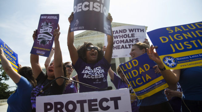 Pro-choice activists celebrate during a rally at the Supreme Court, Monday, June 27, 2016, in Washington. The Supreme Court struck down Texas' widely replicated regulation of abortion clinics Monday in the court's biggest abortion case in nearly a quarter century.The justices voted 5-3 in favor of Texas clinics that had argued the regulations were a thinly veiled attempt to make it harder for women to get an abortion in the nation's second-most populous state. (AP Photo/Evan Vucci)