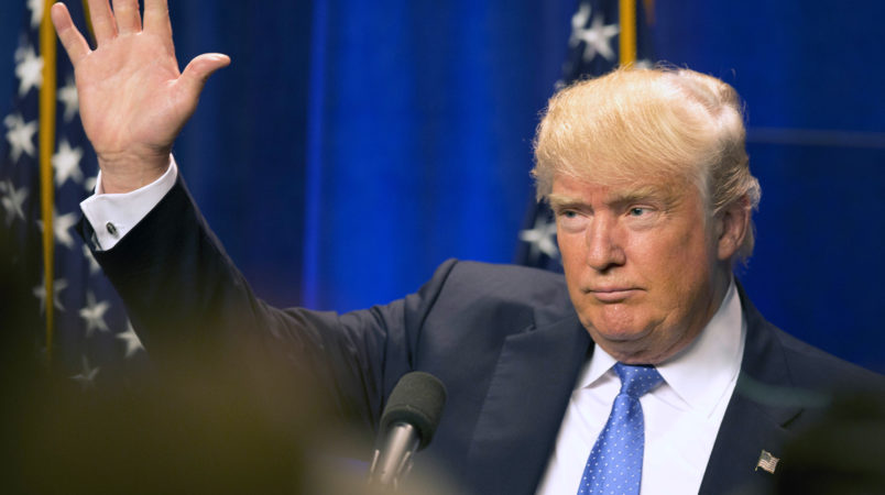 Republican presidential candidate Donald Trump waves to supporters after giving a speach at Saint Anselm College Monday, June 13, 2016, in Manchester, N.H. (AP Photo/Jim Cole)