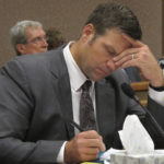 Kansas Secretary of State Kris Kobach listens and takes note as a judge declares in Shawnee County District Court that the state must count potentially thousands of votes from people who registered without providing documentation of their U.S. citizenship, Friday, July 29, 2016, in Topeka, Kan. Kobach had directed local election officials to count only their votes in federal races, not state and local ones. (AP Photo/John Hanna)