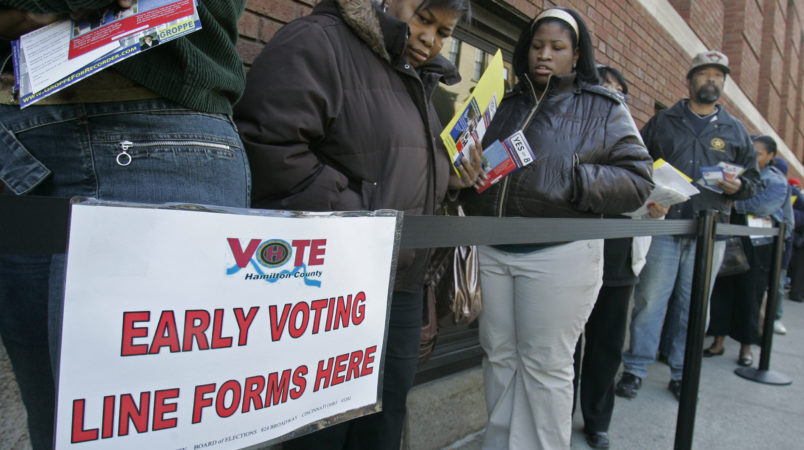 FILE - In this file photo taken Oct. 29, 2008, voters line up outside the Hamilton County Board of Elections for early voting in Cincinnati. U.S. District Judge Michael Watson ruled Tuesday, May 24, 2016, that a law trimming early voting in Ohio is unconstitutional, after the state's Democratic Party and other plaintiffs sued over Republican-backed changes to voting rules in the presidential battleground state. (AP Photo/Al Behrman, File)