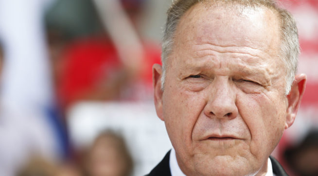 Alabama Chief Justice Roy Moore speaks to the media during a press conference, Monday, Aug. 8, 2016, in Montgomery, Ala. The chief justice continues to fight against gay marriage in Alabama. Moore has been suspended from office after the Judicial Inquiry Commission accused him of violating the canons of judicial ethics with his actions during the fight over same-sex marriage. Moore will attend a hearing Monday that will determine the course of the judicial ethics case against the suspended Alabama Chief Justice. (AP Photo/Brynn Anderson)
