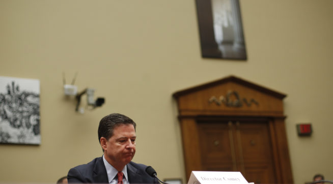 FBI Director James B. Comey waits to testify at the House Judiciary Committee hearing on Capitol Hill in Washington, Wednesday, Sept. 28, 2016. For the second time in two days, FBI Director James Comey faces questions from Congress about the agency's response to recent acts of extremist violence and whether more could have been done to prevent attacks in Orlando and New York. (AP Photo/Pablo Martinez Monsivais)