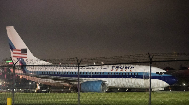 Republican presidential candidate Indiana Gov. Mike Pence's campaign airplane sits partially on the tarmac and the grass after sliding off the runway while landing at LaGuardia airport, Thursday, Oct. 27, 2016, in New York. (AP Photo/Mary Altaffer)