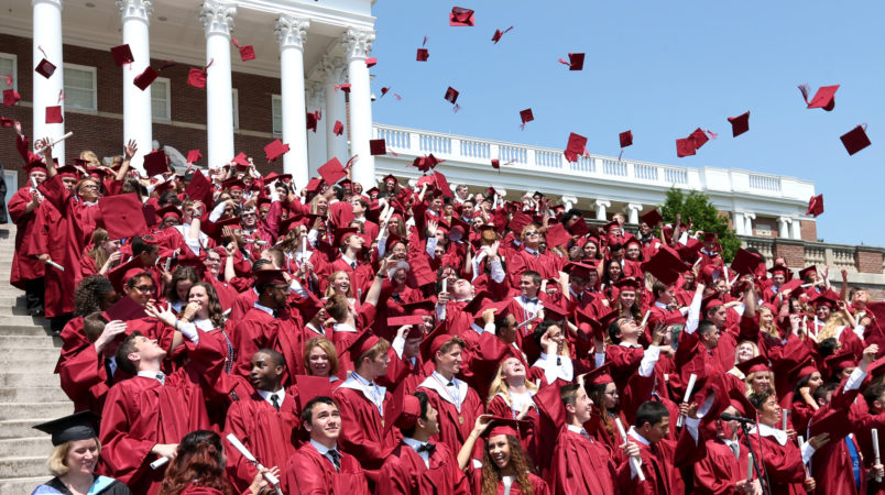 Members of the John Handley High School Class of 2016 toss their mortarboards in the air during commencement exercises at the Winchester, Va. school Saturday, May 28, 2016. (AP Photo, The Winchester Star, Jeff Taylor)
