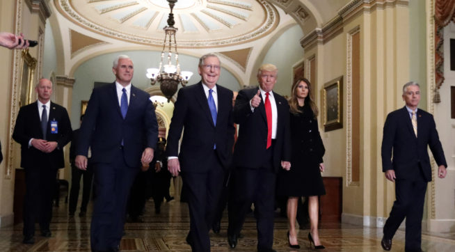 Vice president-elect Mike Pence, second from  left, Senate Majority Leader Mitch McConnell, of Kentucky, President-elect Donald Trump, giving a thumbs up, and Milania Trump walk to a meeting on Capitol Hill, Thursday, Nov. 10, 2016 in Washington. (AP Photo/Alex Brandon)
