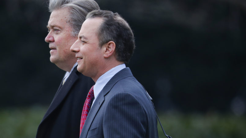 Chief White House Strategist Steve Bannon, left, walks with White House Chief of Staff Reince Priebus, right, to Marine One on the South Lawn of the White House in Washington, Friday, Feb. 17, 2017. (AP Photo/Pablo Martinez Monsivais)