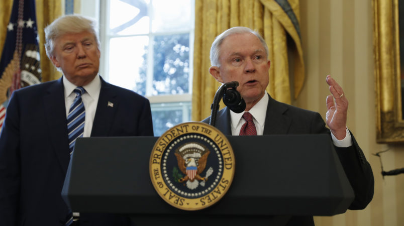 President Donald Trump watches as Vice President Mike Pence administers the oath of office to Attorney General Jeff Sessions, accompanied by his wife Mary, Thursday, Feb. 9, 2017, in the Oval Office of the White House in Washington. (AP Photo/Pablo Martinez Monsivais)