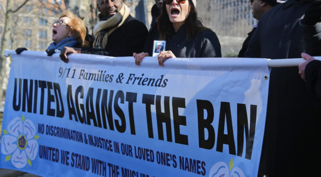 """A recently formed group of Sept. 11 families and supporters rally during a press conference, Thursday Feb. 16, 2017, in Battery Park, N.Y. Group spokesman John Sigmund, who lost his sister Johanna Sigmund in the Sept. 11 attacks, said the group """"9/11 Families and Friends United Against the Ban,"""" came together two weeks ago ago speak """"out against this deplorable Muslim ban that was in the recent executive order by President Trump.""""(AP Photo/Bebeto Matthews)"""