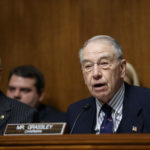 Senate Judiciary Committee Chairman Chuck Grassley, R-Iowa, joined at left by Sen. Orrin Hatch, R-Utah, opens a confirmation hearing for federal prosecutor Rod Rosenstein to be deputy attorney and Rachel Brand to be associate attorney general, on Capitol Hill in Washington, Tuesday, March 7, 2017. (AP Photo/J. Scott Applewhite)