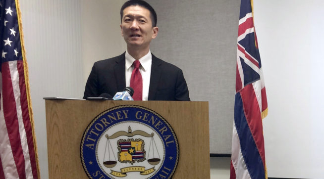 FILE - In this Feb. 3, 2017, file photo, Hawaii Attorney General Doug Chin speaks at a news conference in Honolulu announcing the state of Hawaii has filed a lawsuit challenging President Donald Trump's travel ban. Hawaii is planning to challenge Trump's revised travel ban. A motion filed in federal court on Tuesday, March 7, 2017, in Honolulu says the state wants to amend its existing lawsuit challenging Trump's previous order.  (AP Photo/Audrey McAvoy, File)