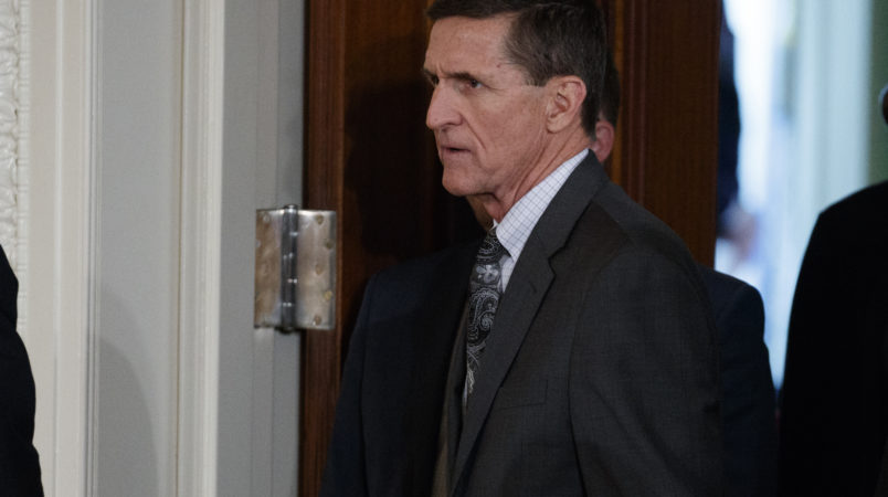 Former National Security Adviser Mike Flynn arrives for a news conference in the East Room of the White House, Monday, Feb. 13, 2017, in Washington. (AP Photo/Evan Vucci)