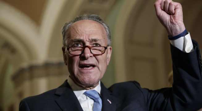 Senate Minority Leader Chuck Schumer D-N.Y. meets with reporters on Capitol Hill before President Donald Trump's speech to the nation in Washington Tuesday Feb. 28 2017. Referring to Trump Schumer said it was amazing in a month how incompetent