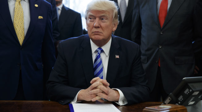 President Donald Trump announces the approval of a permit Friday to build the Keystone XL pipeline, clearing the way for the $8 billion project, in the Oval Office of the White House, Friday, March 24, 2017, in Washington. (AP Photo/Evan Vucci)