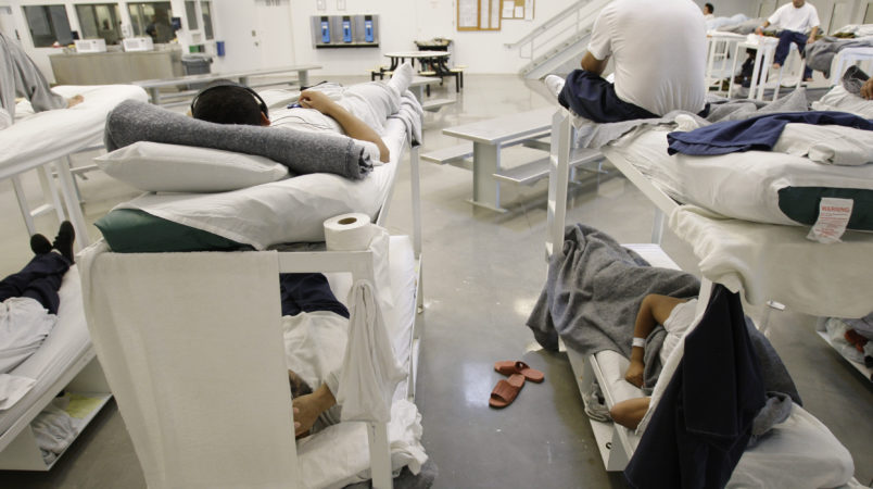 """** ATTENTION HOLD FOR GRAHAM MORRISON ** Detainees are shown resting on bunks inside the """"B"""" cell and bunk unit of the Northwest Detention Center in Tacoma, Wash. Friday, Oct. 17, 2008. The facility is operated by The GEO Group Inc. under contract from U.S. Immigrations and Customs Enforcement, and houses people whose immigration status is in question or who are waiting for deportation or deportation hearings. (AP Photo/Ted S. Warren)"""