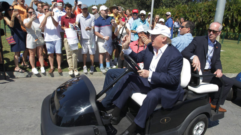 Republican presidential candidate Donald Trump drives himself around the golf course to watch the final round of the Cadillac Championship golf tournament, Sunday, March 6, 2016, in Doral, Fla. (AP Photo/Luis Alvarez)