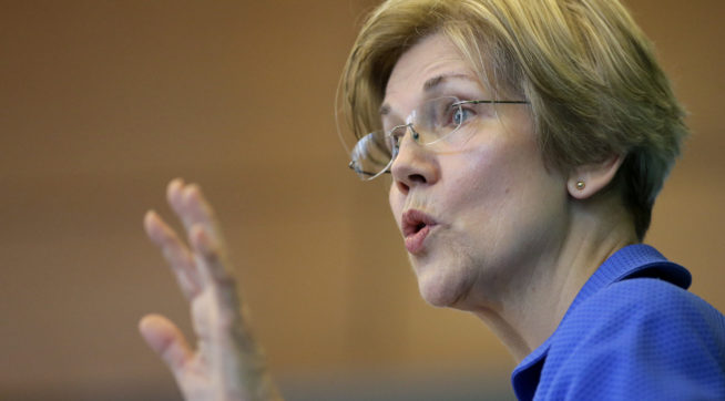 U.S. Sen. Elizabeth Warren, D-Mass., addresses business leaders during a New England Council luncheon at a hotel, Monday, March 27, 2017, in Boston. (AP Photo/Steven Senne)