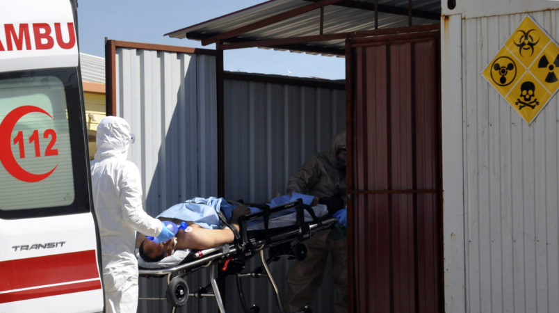A Turkish expert evacuateS a victim of alleged chemical weapons attacks in Syrian city of Idlib, at a local hospital in Reyhanli, Hatay, Turkey, Tuesday, April 4, 2017. A suspected chemical attack in a town in Syria's rebel-held northern Idlib province killed dozens of people on Tuesday, opposition activists said, describing the attack as among the worst in the country's six-year civil war. (DHA-Depo Photos via AP)