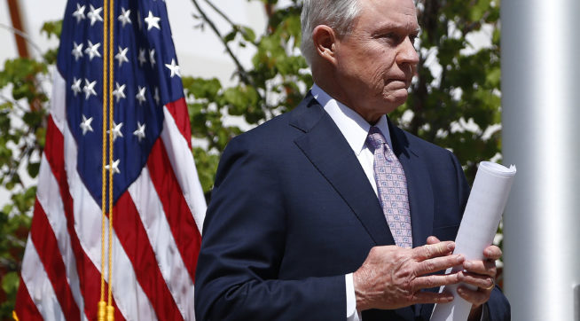 After answering questions, Attorney General Jeff Sessions leaves a press conference after touring the U.S.-Mexico border with border officials Tuesday, April 11, 2017, in Nogales, Ariz.  Sessions announced making immigration enforcement a key Justice Department priority, saying he will speed up deportations of immigrants in the country illegally who were convicted of federal crimes. (AP Photo/Ross D. Franklin)