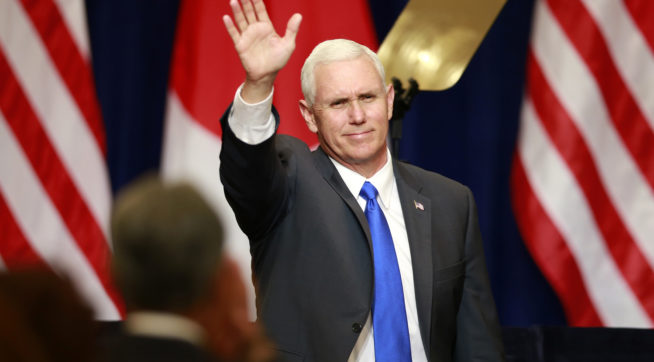 U.S. Vice President Mike Pence waves during a lecture for Japan-U.S. business leaders at a hotel in Tokyo, Wednesday, April 19, 2017. (AP Photo/Shizuo Kambayashi)