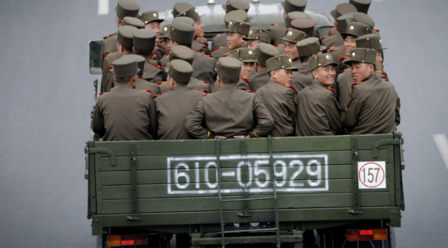 North Korean sit at the back of a truck as it drives along Mirae Scientists Street on Wednesday, April 19, 2017, in Pyongyang, North Korea which just celebrated its late leader Kim Il Sung's 105th birth anniversary with a military parade. (AP Photo/Wong Maye-E)