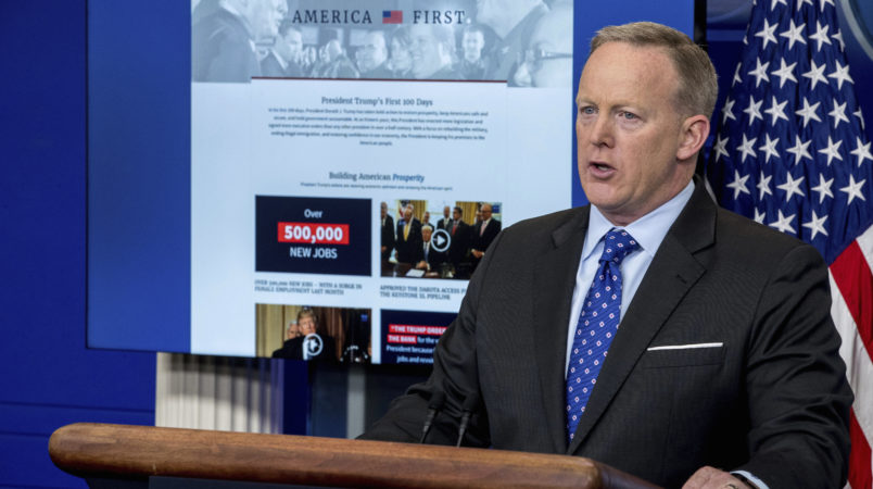 A new website that the White House has launched on President Donald Trump's first 100 days is displayed in front of White House press secretary Sean Spicer as he speaks to the media during the daily press briefing at the White House, Tuesday, April 25, 2017, in Washington. (AP Photo/Andrew Harnik)