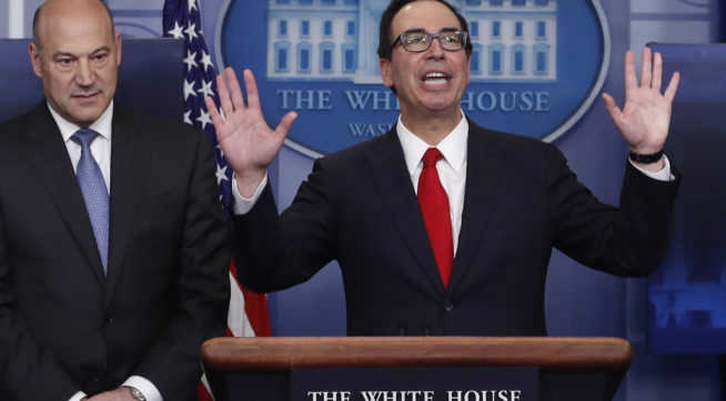 Treasury Secretary Steven Mnuchin, joined by National Economic Director Gary Cohn, speaks in the briefing room of the White House, in Washington, Wednesday, April 26, 2017. President Donald Trump is proposing dramatically reducing the taxes paid by corporations big and small in an overhaul his administration says will spur economic growth and bring jobs and prosperity to the middle class. (AP Photo/Carolyn Kaster)