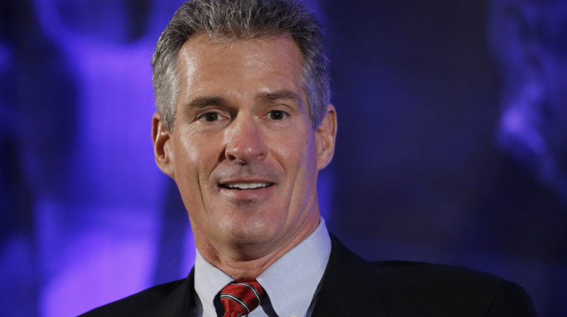 Former Massachusetts Sen. Scott Brown speaks Saturday, Jan. 23, 2016, at the New Hampshire Republican Party summit in Nashua, N.H. (AP Photo/Matt Rourke)