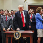 President Donald Trump, center, surrounded by Congressional and business leaders, gets up from his seat after signing an Executive Order in the Roosevelt Room of the White House in Washington, Friday, April 28, 2017. The Executive Order directs the Interior Department to begin review of restrictive drilling policies for the outer-continental shelf. (AP Photo/Pablo Martinez Monsivais)