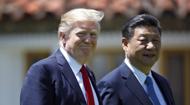 President Donald Trump and Chinese President Xi Jinping walk together after their meetings at Mar-a-Lago, Friday, April 7, 2017, in Palm Beach, Fla. (AP Photo/Alex Brandon)