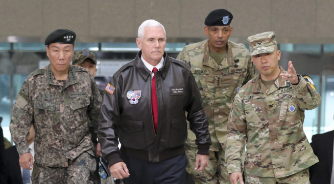 "U.S. Vice President Mike Pence arrives with U.S. Gen. Vincent Brooks, second from right, commander of the United Nations Command, US Forces Korea and Combined Forces Command, and South Korean Deputy Commander of the Combined Force Command Gen. Leem Ho-young, left, at the border village of Panmunjom in the Demilitarized Zone (DMZ) which has separated the two Koreas since the Korean War, South Korea, Monday, April 17, 2017.  Viewing his adversaries in the distance, U.S. Vice President Mike Pence traveled to the tense zone dividing North and South Korea and warned Pyongyang that after years of testing the U.S. and South Korea with its nuclear ambitions, ""the era of strategic patience is over."" (AP Photo/Lee Jin-man)"