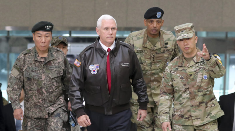 """U.S. Vice President Mike Pence arrives with U.S. Gen. Vincent Brooks, second from right, commander of the United Nations Command, US Forces Korea and Combined Forces Command, and South Korean Deputy Commander of the Combined Force Command Gen. Leem Ho-young, left, at the border village of Panmunjom in the Demilitarized Zone (DMZ) which has separated the two Koreas since the Korean War, South Korea, Monday, April 17, 2017.  Viewing his adversaries in the distance, U.S. Vice President Mike Pence traveled to the tense zone dividing North and South Korea and warned Pyongyang that after years of testing the U.S. and South Korea with its nuclear ambitions, """"the era of strategic patience is over."""" (AP Photo/Lee Jin-man)"""