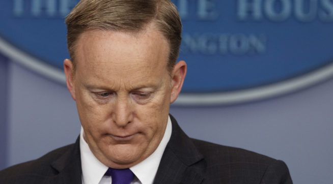 White House press secretary Sean Spicer listens to a question during the daily press briefing, Thursday, March 30, 2017, in Washington. (AP Photo/Evan Vucci)