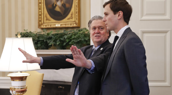 Counselor to the President of the United States, Steve Bannon, left, talks with White House senior advisers Jared Kushner, right, in the Oval Office of the White House in Washington, Friday, Feb. 3, 2017. (AP Photo/Pablo Martinez Monsivais)