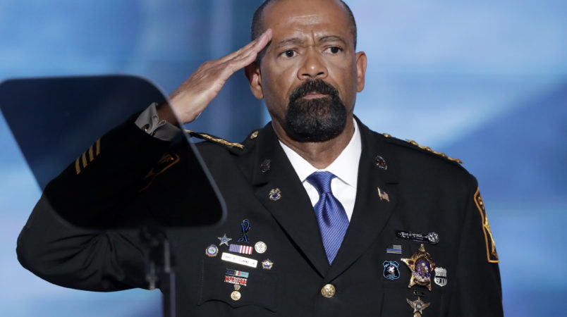 David Clarke, Sheriff of Milwaukee County, Wis., salutes after speaking during the opening day of the Republican National Convention in Cleveland, Monday, July 18, 2016. (AP Photo/J. Scott Applewhite)