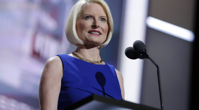Callista Gingrich tests the speaking setup before the third day session of the GOP 2016 Convention, Wednesday, July 20, 2016, in Cleveland. (AP Photo/John Locher)