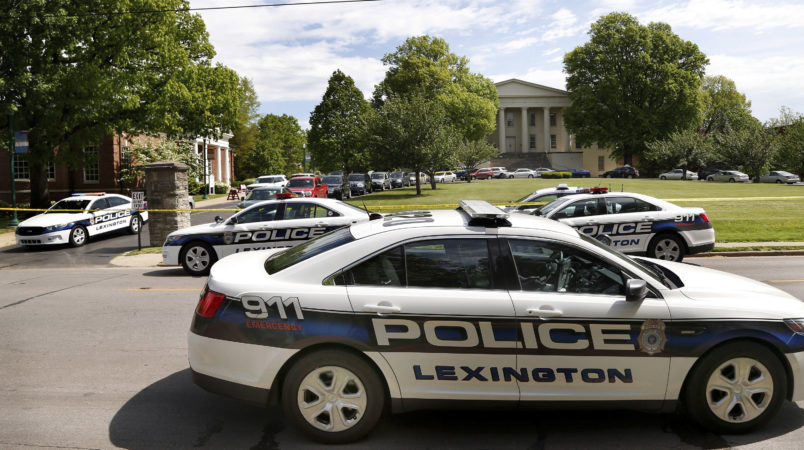 Police officers at the scene of a stabbing on the Transylvania University campus in Lexington, Ky., Friday, April 28, 2017. A student was injured and another was arrested after a machete attack Friday morning at a Transylvania University coffee shop, according to Lexington police. The assailant, thought to be a former student, was armed with a machete and knives, Lexington Police Chief Mark Barnard said. The university canceled classes for the rest of the day. The stabbing occurred at a coffee shop inside the Glenn Building, on the left.