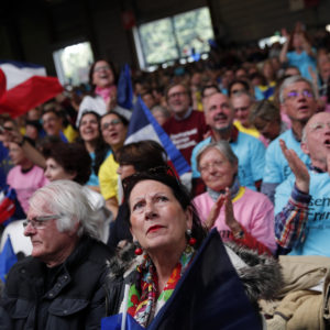 Supporters of French independent centrist presidential candidate Emmanuel Macron attends a campaign rally in Paris, France, Monday, May 1st, 2017. With just six days until a French presidential vote that could define Europe's future, far-right leader Marine Le Pen and centrist Emmanuel Macron are holding high-stakes rallies Monday. (AP Photo/Christophe Ena)