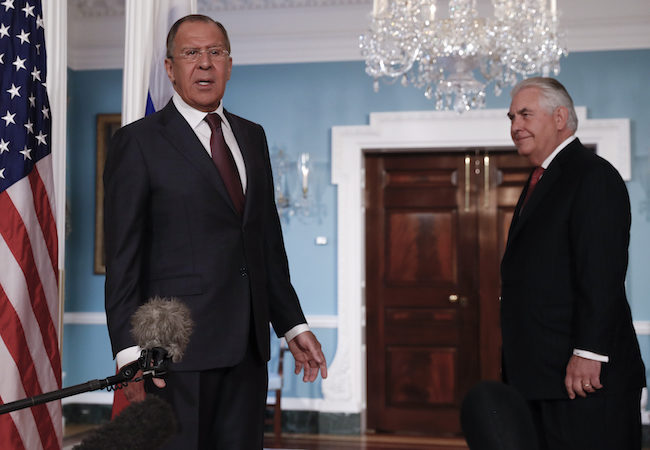Secretary of State Rex Tillerson, right, looks to Russian Foreign Minister Sergey Lavrov as he speak to media at the State Department in Washington, Wednesday, May 10, 2017. (AP Photo/Carolyn Kaster)