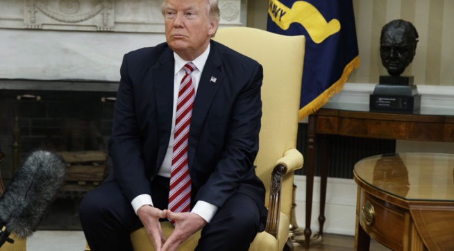 President Donald Trump pauses after speaking to reporters during a meeting with former Secretary of State Henry Kissinger in the Oval Office of the White House, Wednesday, May 10, 2017, in Washington. (AP Photo/Evan Vucci)