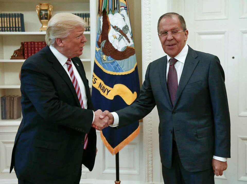 President Donald Trump shakes hands with Russian Russian Foreign Minister Sergey Lavrov in the White House in Washington, Wednesday, May 10, 2017.President Donald Trump on Wednesday welcomed Vladimir Putin's top diplomat to the White House for Trump's highest level face-to-face contact with a Russian government official since he took office in January. (Russian Foreign Ministry Photo via AP)