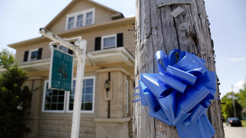 A blue ribbon adorns a telephone pole outside the Pine Kirk Care Center on Saturday, May 13, 2017 in Kirkersville, Ohio. The nursing home was the site of a fatal shooting on Friday, May 12, 2017 after Thomas Hartless, 43, of Utica, shot Kirkersville police chief Steven DiSario, nurse Marlina Medrano and nurse's aide Cindy Krantz. Hartless was later found dead inside the nursing home. [Joshua A. Bickel/Dispatch]