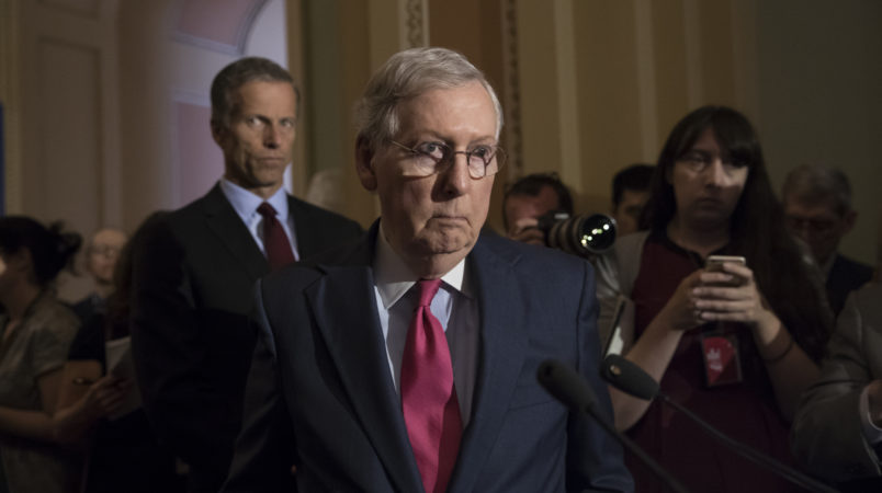 Senate Majority Leader Mitch McConnell, R-Ky., joined at left by Sen. John Thune, R-S.D., reacts to questions from reporters about President Donald Trump reportedly sharing classified information with two Russian diplomats during a meeting in the Oval Office, at the Capitol in Washington, Tuesday, May 16, 2017. (AP Photo/J. Scott Applewhite)