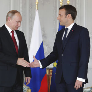 President Emmanuel Macron, right,  shakes hands with his Russian counterpart Vladimir Putin as they meet for talks before the opening of an exhibition marking 300 years of diplomatic ties between the two countyies at Palace of Versailles in Versailles, near Paris, France, Monday, May 29, 2017. Monday's meeting comes in the wake of the Group of Seven's summit over the weekend where relations with Russia were part of the agenda, making Macron the first Western leader to speak to Putin after the talks. (Philippe Wojazer/Pool Photo via AP)