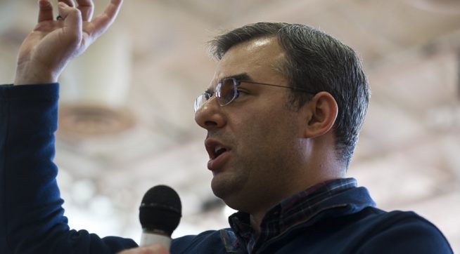 U.S Rep. Justin Amash, R-Cascade Township, speaks to the audience during a town hall meeting on Feb. 23, 2017 at the Full Blast Recreation Center in Battle Creek, Mich. (Carly Geraci | MLive.com)