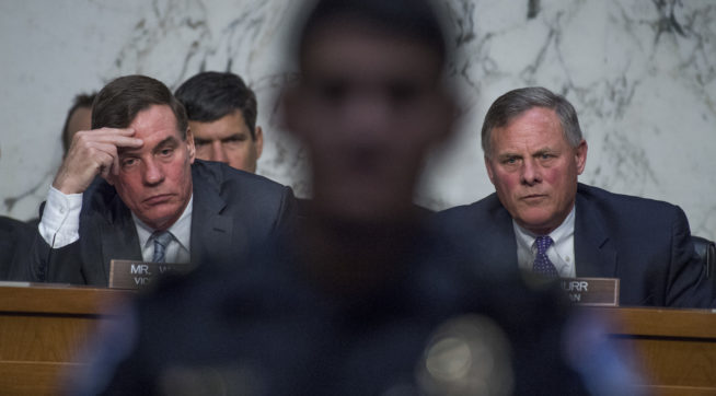 """UNITED STATES - MAY 11: Chairman Richard Burr, R-N.C., right, and Ranking Member Mark Warner, D-Va., conduct  a Senate (Select) Intelligence Committee hearing in Hart Building titled """"World Wide Threats"""" on May 11, 2017. (Photo By Tom Williams/CQ Roll Call)"""