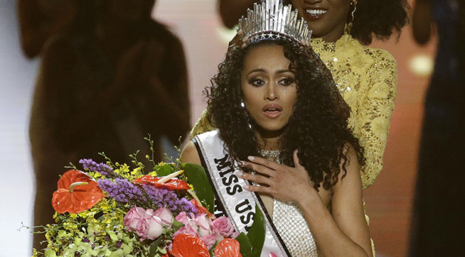 Miss District of Columbia USA Kara McCullough reacts as she is crowned the new Miss USA by former Miss USA Deshauna Barber during the Miss USA contest Sunday, May 14, 2017, in Las Vegas. (AP Photo/John Locher)
