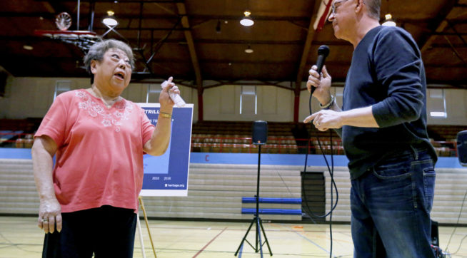 Rae Seaton, of Dubuque, Iowa, challenges U.S. Rep. Rod Blum, R-Iowa, on his answer to her healthcare question during a town hall in the Nora Gymnasium at Dubuque Senior High School in Dubuque, Iowa, on Monday, May 8, 2017.