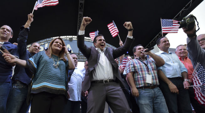 Governor Ricardo Rossello and Washington resident commissioner Jennifer Gonzalez celebrate at the headquarters of the New Progressive Party after learning about their victory in the political status referendum, in San Juan, Puerto Rico, Sunday, June 11, 2017. After the triumph of statehood in the status consultation, Rossello will move to Washington, DC, to report the results to Congress, the White House and various international forums.  (AP Photo/Carlos Giusti) PUERTO RICO OUT-NO PUBLICAR EN PUERTO RICO